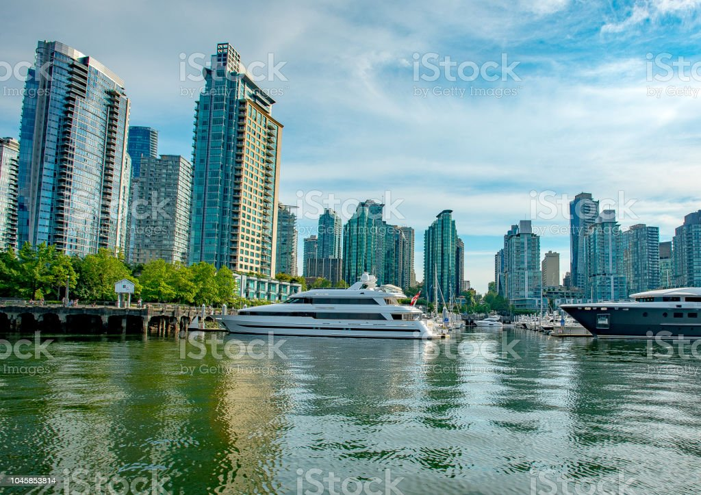 West Vancouver marina view with high rise buildings behind moored boats stock photo