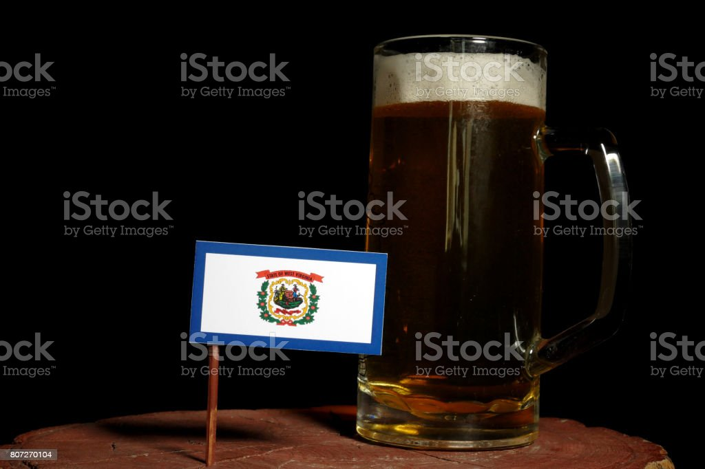 West Virginia flag with beer mug isolated on black background stock photo
