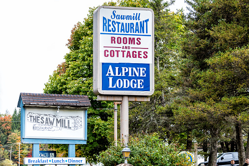 Davis, USA - October 5, 2020: West Virginia small vintage downtown near Blackwater Falls State park with sign for sawmill restaurant and alpine lodge hotel room