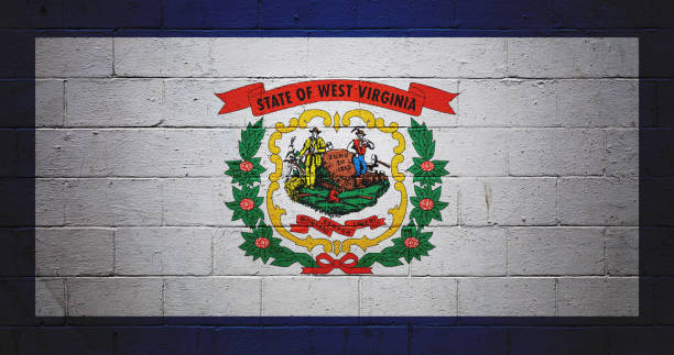 West Virginia state flag painted on a wall Flag of the West Virginia painted on a brick wall. west virginia us state stock pictures, royalty-free photos & images
