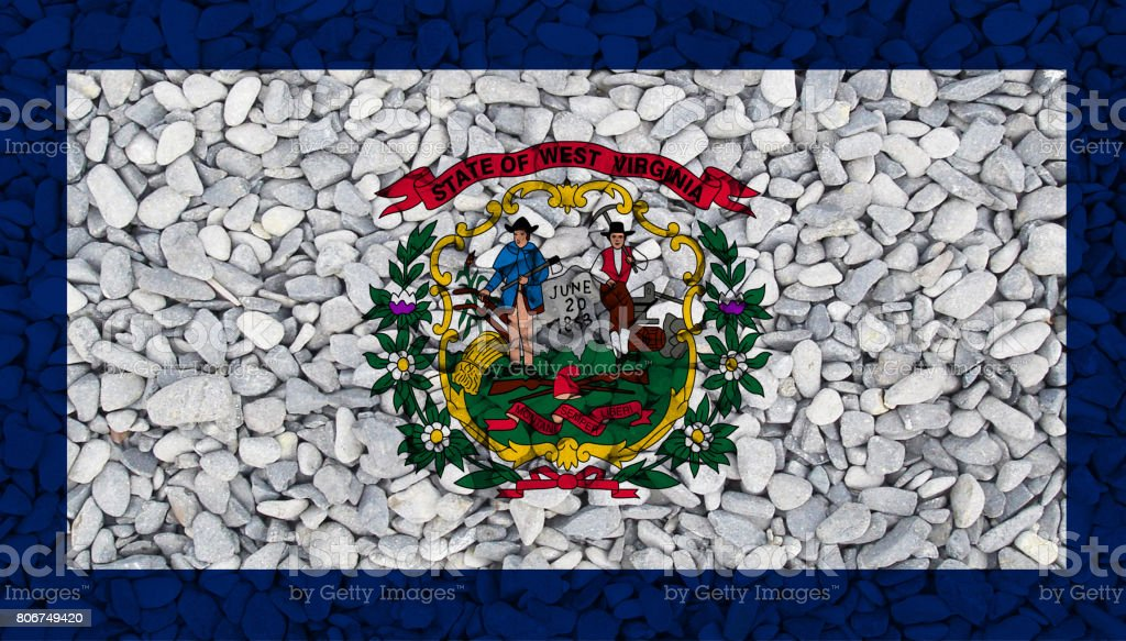 West Virginia State flag painted on stones in nature stock photo