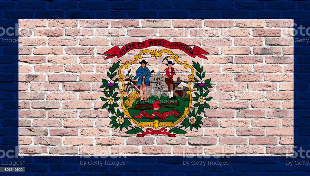 West Virginia State flag painted over brick wall stock photo