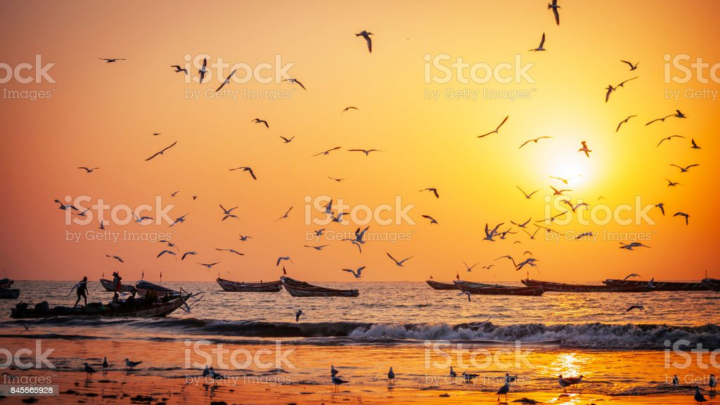 West-African fishing boats in sunset light - The Gambia stock photo