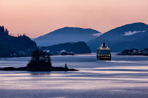 MS Westerdam Sailing Into Ketchikan at Dawn Ketchikan, USA - August 27, 2015: Holland America Line cruise ship Westerdam entering Ketchikan, Alaska, at dawn. ketchikan stock pictures, royalty-free photos & images