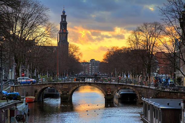 westerkerk sunset bridge - westerkerk stockfoto's en -beelden