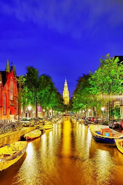westerkerk (western church), with water canal view in amsterdam. - westerkerk stockfoto's en -beelden