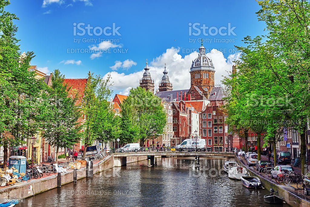 Westerkerk (Western Church), with water canal view in Amsterdam. stock photo