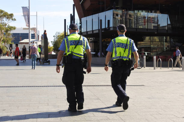 Western Australia police offices patrolling in Perth financial district stock photo