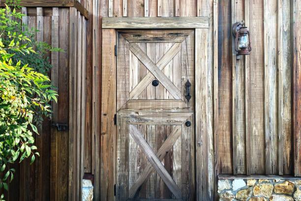 western barn shed door lantern stock photo
