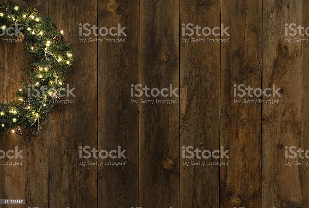 western barnwood background wlighted christmas wreath stock photo