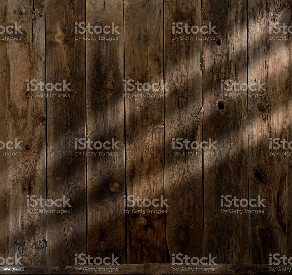 Western barnwood plank wall w/sun streaks-blank,copy space royalty-free stock photo