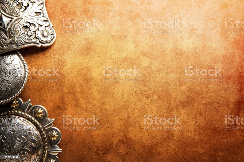 Western Belt Buckles On Textured Leather Surface stock photo