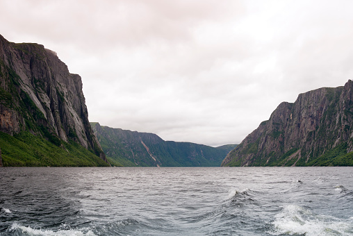Beautiful fjord-like Western Brook Pond near Rocky Harbour on a cloudy day, Gros Morne National Park, Newfoundland,Canada.