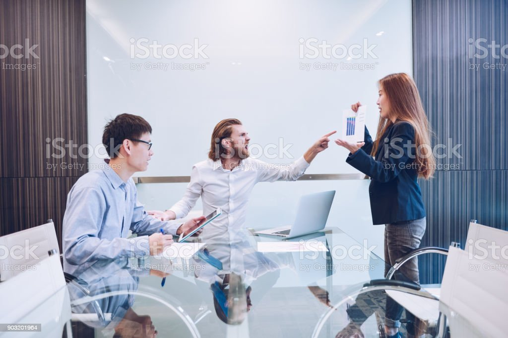Western businessman blaming his employee in office, problem stock photo
