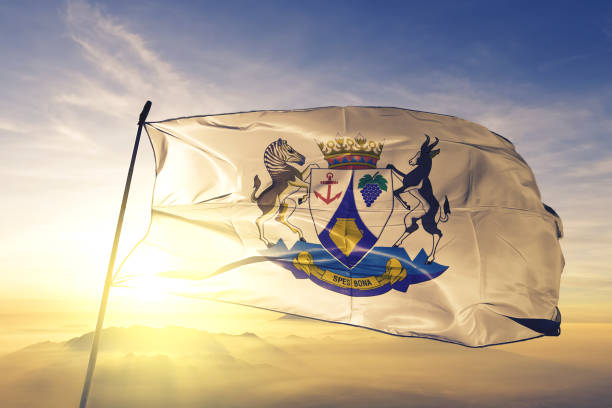Western Cape province of South Africa flag textile cloth fabric waving on the top sunrise mist fog stock photo