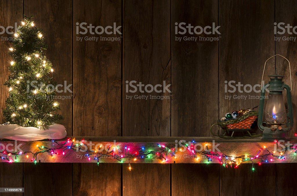 Western Christmas w/tree  on mantel royalty-free stock photo