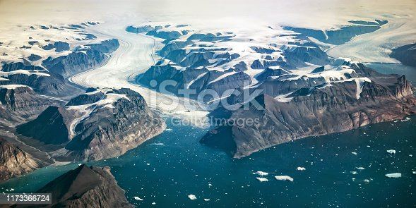 istock Western coast of Greenland, aerial view of glacier,  mountains and ocean 1173366724