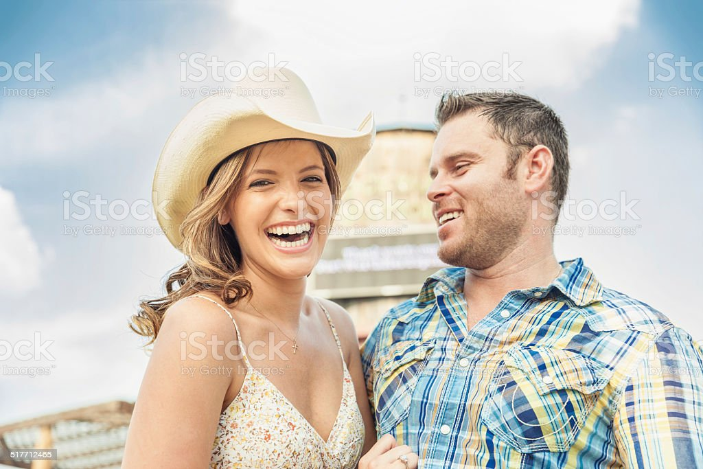 Western Couple Laughing and Having Fun Together stock photo