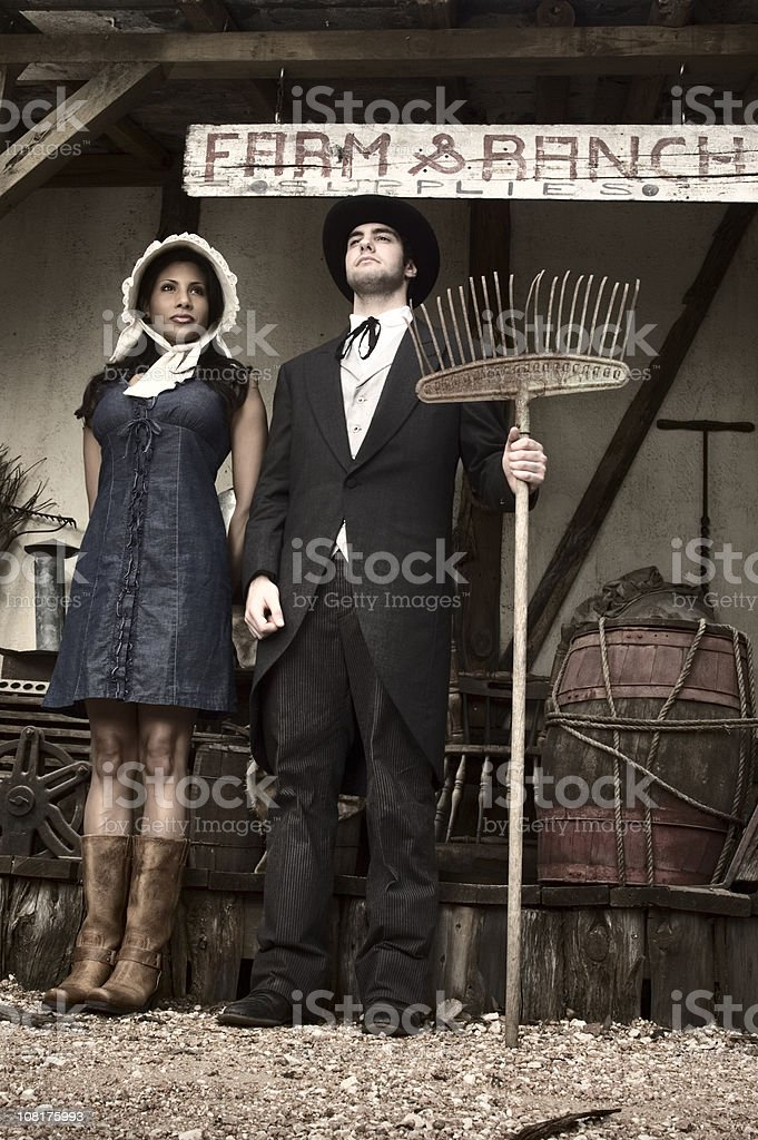 Western Couple Standing at Farm Ranch stock photo
