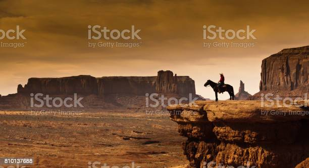 Photo of Western Cowboy Native American on Horseback at Monument Valley Tribal Park