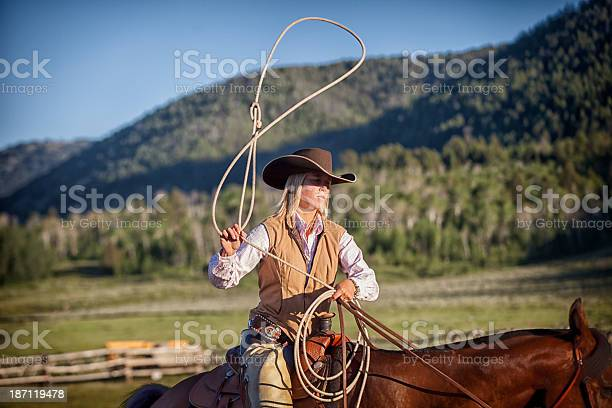 Western Cowgirl Lassoing on Horseback