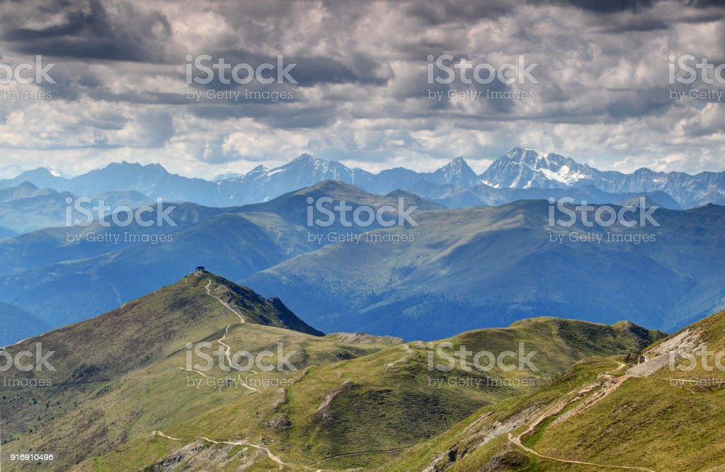 Western end of Carnic Alps main ridge with snowy High Tauern stock photo