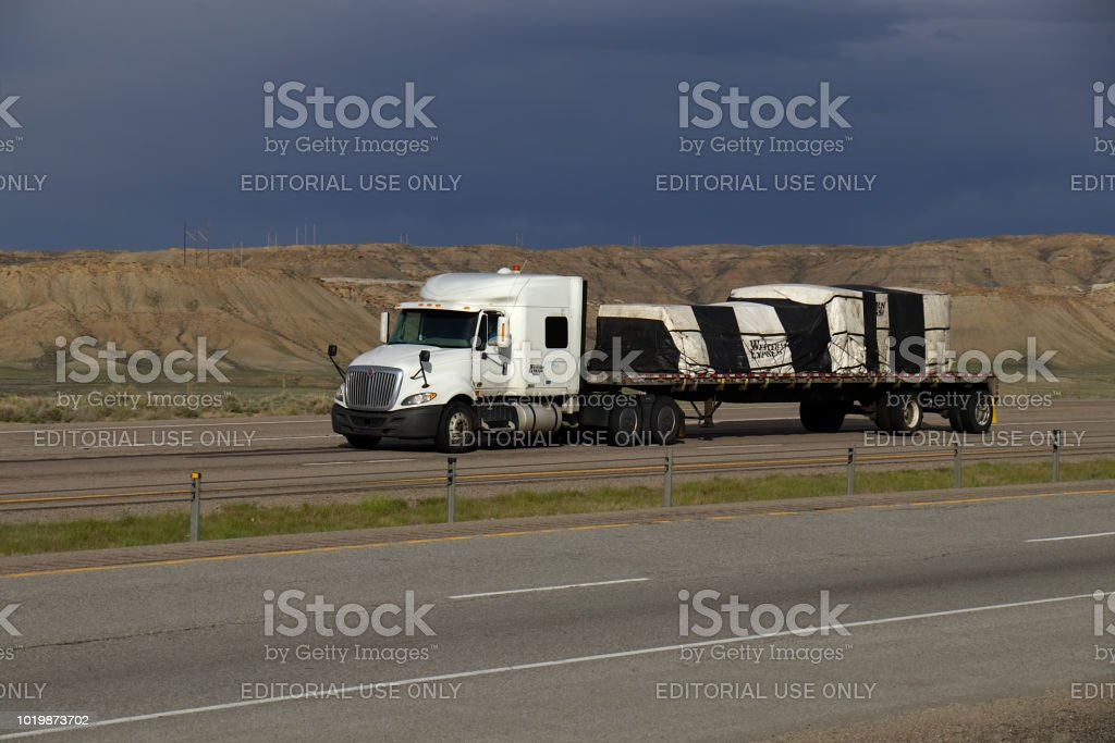 Western Express Flatbed Semitruck Stock Photo - Download