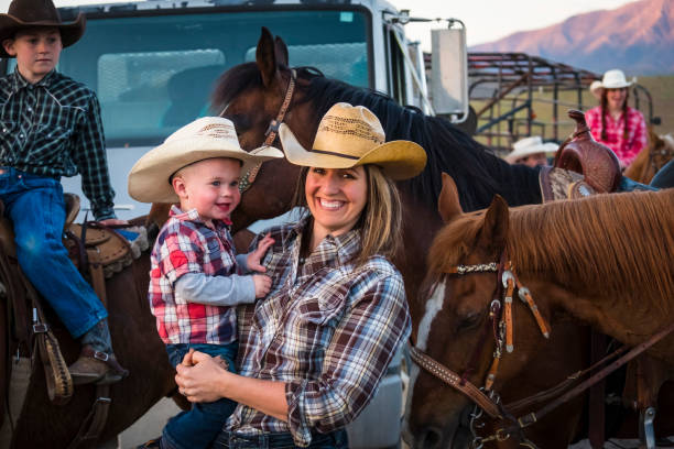 Western Family On Horseback. stock photo