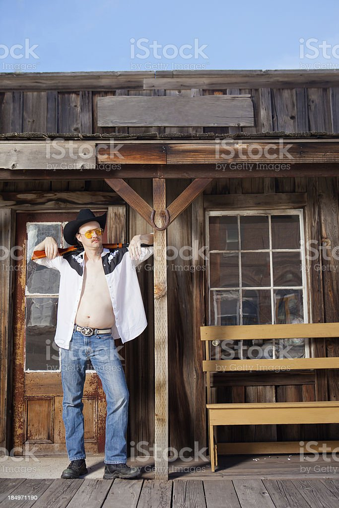 Western Man Beside A Wooden Building Amp Weapon Stock Photo More