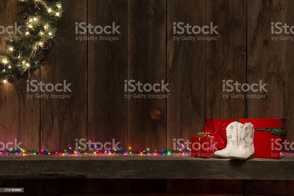 western mantel wchristmas lightswreathred gift boxes barnwood background royalty