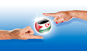 Western Sahara button national flag floating between human hands