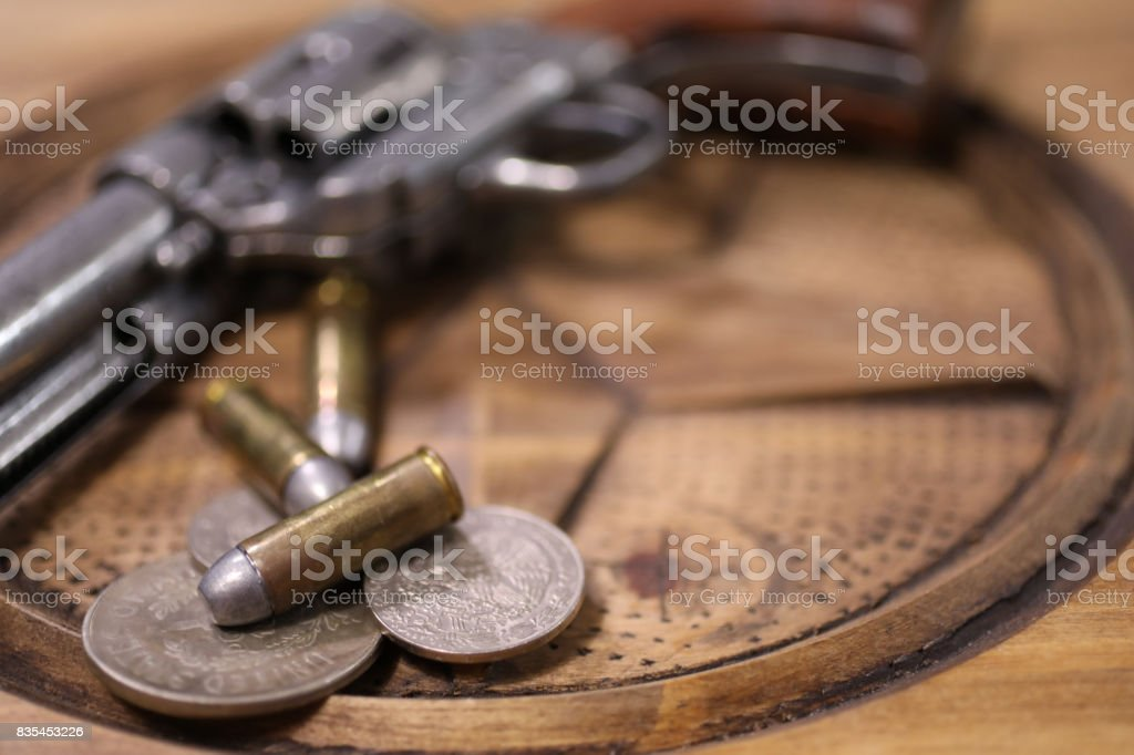 Old western Six Shooter with bullets and old American and Mexican...