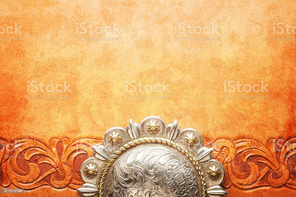 Western Style Belt Buckle On Tooled Leather Surface stock photo