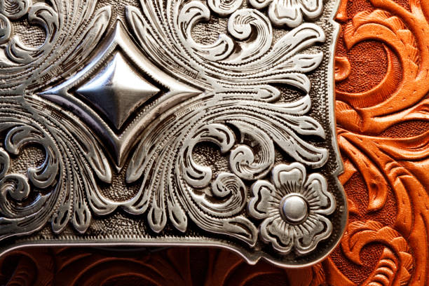 western style belt buckle on tooled leather surface - filigree stock photos and pictures