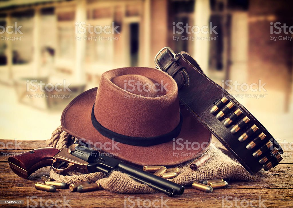 Western style broad brim hat, single shooter gun and belt stock photo