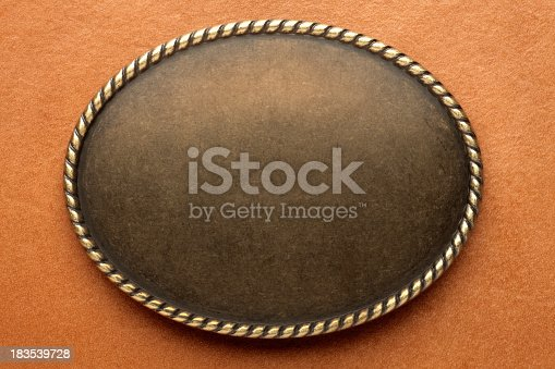 An western style oval frame with.  Add your own text.