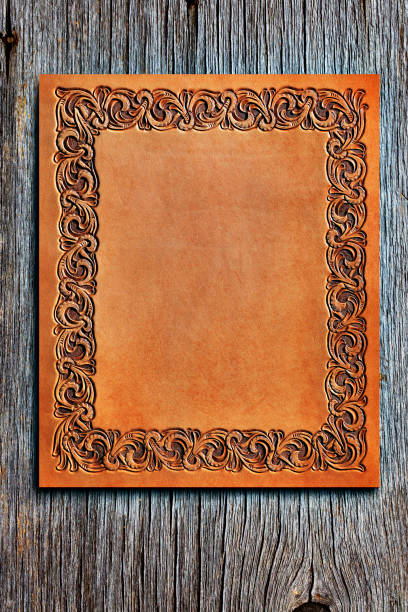 western style tooled leather sitting on old wood - filigree stock photos and pictures