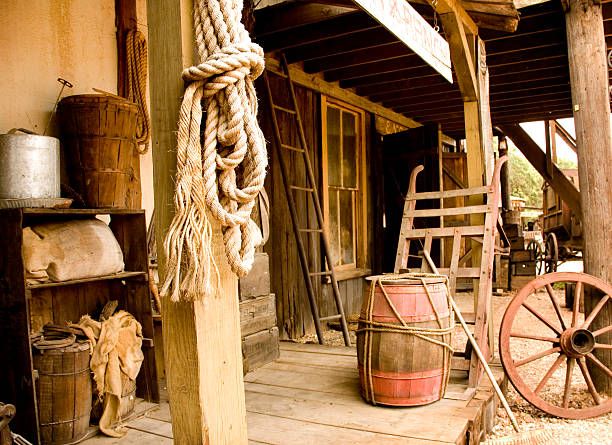 western town boardwalk with livery items on display - western town stock photos and pictures
