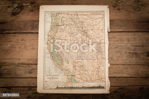 Color stock photo of an antique Western United States map illustration page on an old, wooden trunk. Salvaged from an 1871 geography book.