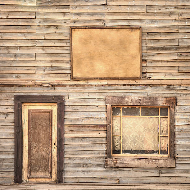 Western vintage wooden facade background. Door, window and blank board Western vintage ranch wooden facade background or pattern. Door, window and blank or empty board saloon stock pictures, royalty-free photos & images