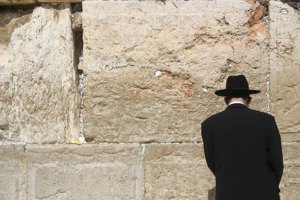 Western Wall Prayer A man prays at the Wailing Wall in Jerusalem judaism stock pictures, royalty-free photos & images