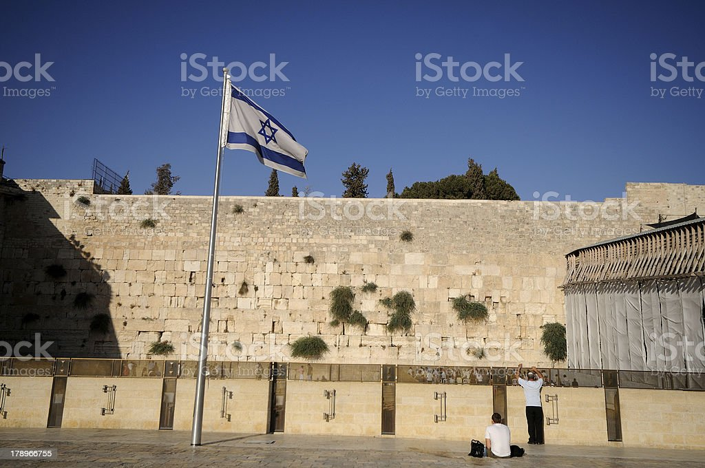 Western wall with the israeli flag royalty-free stock photo