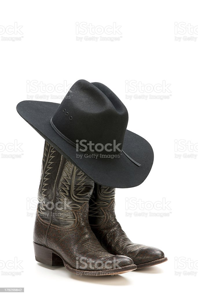 Western/cowboy dress boots and black felt hat-isolated on white royalty-free stock photo