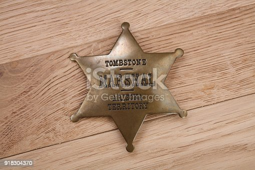 istock Western-style sheriff badge 918304370
