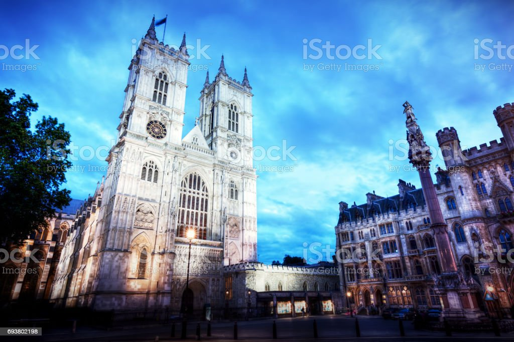 Westminster Abbey church facade at night, London UK. stock photo