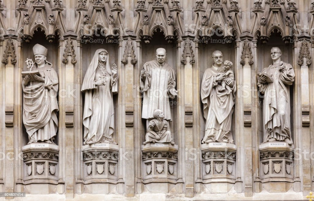 Westminster Abbey facade detail with 20th-century Christian martyrs London UK stock photo