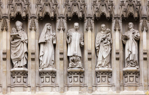 Westminster Abbey facade detail with 20th-century Christian martyrs London UK Westminster Abbey facade detail with 20th-century Christian martyrs Janani Luwum, Grand Duchess Elizabeth of Russia, Martin Luther King Jr., Oscar Romero and Dietrich Bonhoeffer, City of Westminster, Central Area of Greater London, UK religious saint stock pictures, royalty-free photos & images