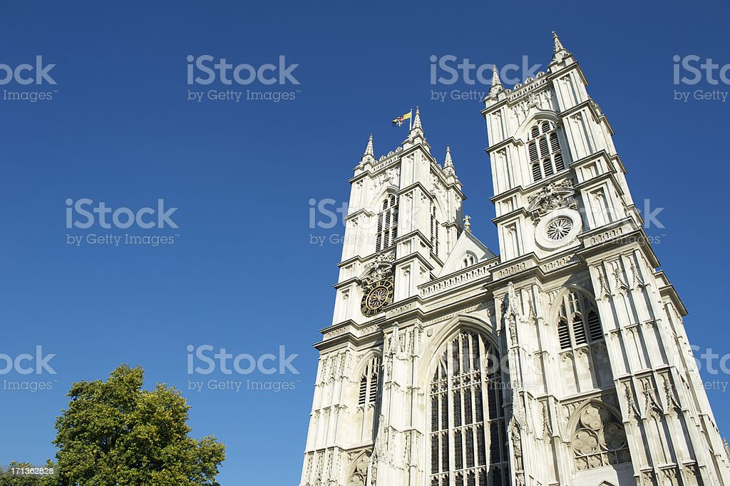 Westminster Abbey London with Bright Blue Sky and Tree stock photo