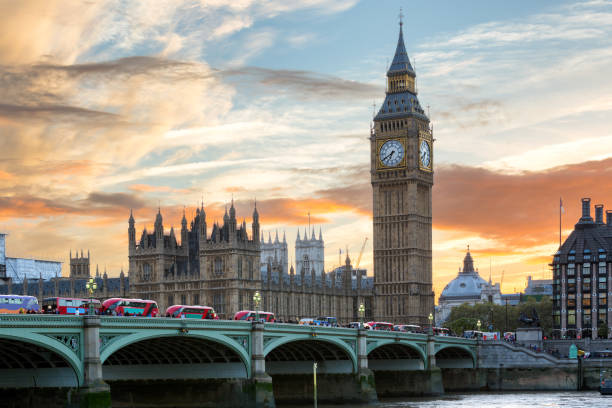Westminster and Big Ben in London during a colorful sunset Panoramic view ot Westminster and Big Ben in London during a colorful sunset london england stock pictures, royalty-free photos & images