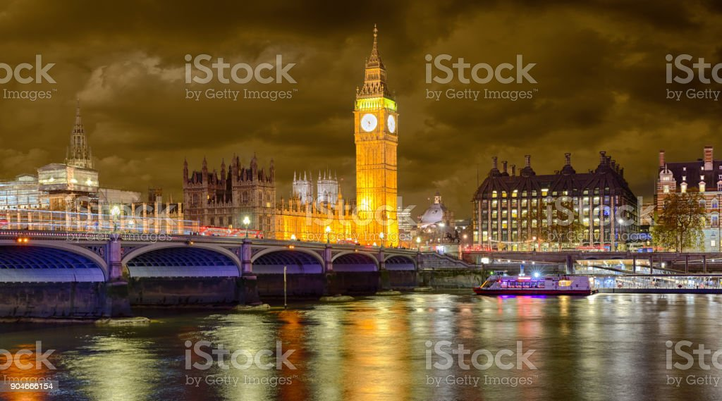 Westminster Bridge and Big Ben on a cloudy winter night stock photo